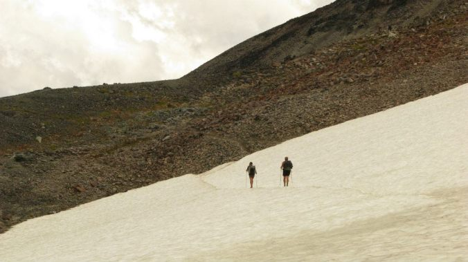 Instigate and I crossing a snow field.